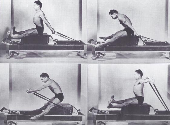 Joseph Pilates doing horseback on the reformer